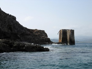 Pillars in the sea. Iron mining?
